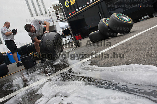 Workers clean used tyres after the free practice session of the Hungarian F1 Grand Prix in Mogyorod (about 20km north-east from Budapest), Hungary. Friday, 29. July 2011. ATTILA VOLGYI