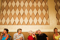 Lois Ostraat, 79, center, chats with Lois Unzelman, 67, second from left, while they watch Lois' husband Myrl Unzelman, 70 (not pictured) play compete at the 36th annual World Series of Poker at the Rio on Thursday July 7, 2005 in Las Vegas, Nevada. Myrl's $10,000 entry fee to play in the tournament was paid for by his three children as a 70th birthday present. Yawning, second from right, is Shawn Unzelman, 22, the great nephew of Lois and Myrl. Thursday marked the start of the no-limit Texas hold'em main event. Approximately 5,600 players are competing for a chance to win the first-place prize of roughly $7.5 million. (Photo by Landon Nordeman/ Getty Images)
