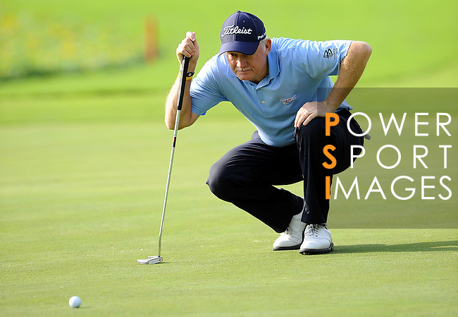 TAIPEI, TAIWAN - NOVEMBER 20:  Roger Chapman of England lines up a putt on the 9th green during day three of the Fubon Senior Open at Miramar Golf & Country Club on November 20, 2011 in Taipei, Taiwan. Photo by Victor Fraile / The Power of Sport Images