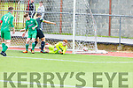 Shamrock Rovers Cian Kelly slips the ball under Kerrys keeper Alex O'Connor despite the efforts of Owen Benson defence in the SSE U17 game in Mounthawk Park on Sunday.