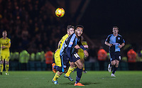 Aaron Amadi-Holloway of Wycombe Wanderers keeps eyes on the ball during the Sky Bet League 2 match between Wycombe Wanderers and Oxford United at Adams Park, High Wycombe, England on 19 December 2015. Photo by Andy Rowland.