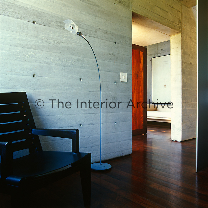 The interior concrete walls retain the marks created during construction and provide a blank canvas for the furniture and modern art with which the house has been decorated