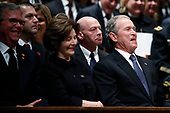Former Florida Gov. Jeb Bush, Laura Bush and former President George W. Bush smile during a State Funeral for former President George H.W. Bush at the Washington National Cathedral, Wednesday, Dec. 5, 2018, in Washington. <br /> Credit: Alex Brandon / Pool via CNP