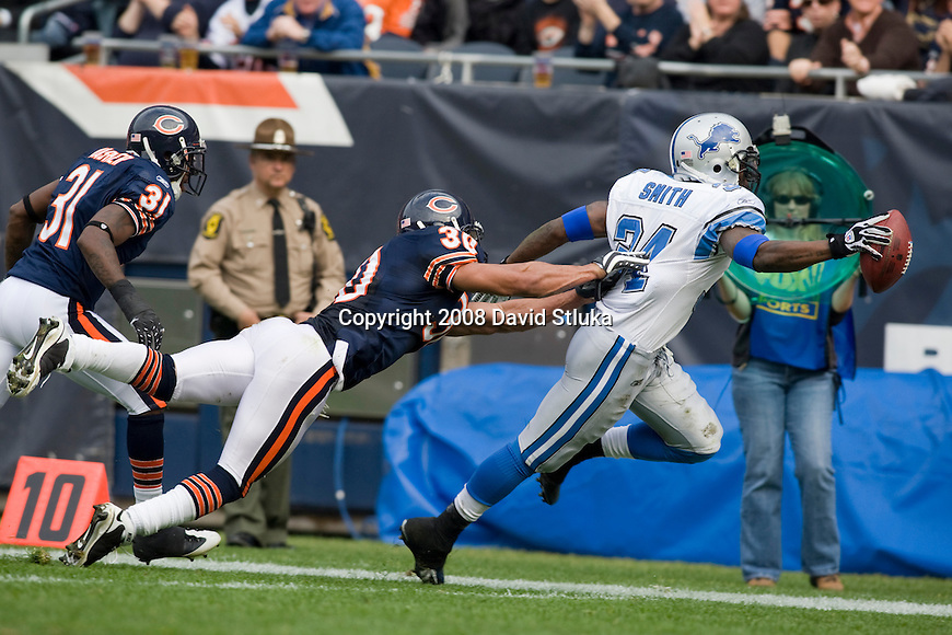 CHICAGO - NOVEMBER 2: Defensive back Mike Brown #30 of the Chicago Bears pushes running back Kevin Smith #34 of the Detroit Lions out of bounds at Soldier Field on November 2, 2008 in Chicago, Illinois. The Bears defeated the Lions 27-23. (Photo by David Stluka)