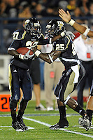 11 September 2010:  FIU defensive back Jose Cheeseborough (27) celebrates his fumble recovery with cornerback Jonathan Cyprien (25) in the third quarter as the Rutgers Scarlet Knights defeated the FIU Golden Panthers, 19-14, at FIU Stadium in Miami, Florida.