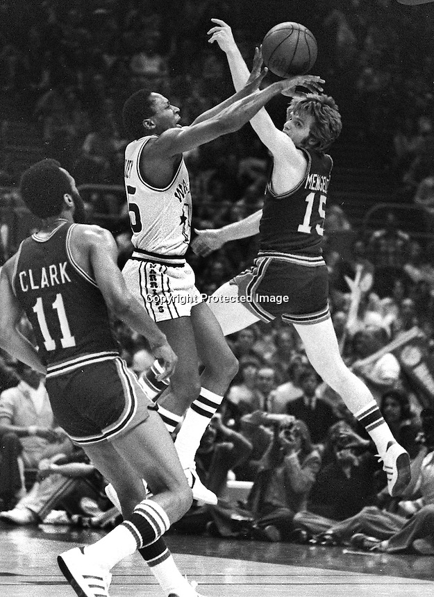 Warrior Charles Dudley shoots over Chris or Kevin Porter    Detroit Piston <br />