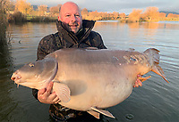 BNPS.co.uk (01202 558833)<br /> Pic: IanBurton/BNPS<br /> <br /> Monster Carp caught by Brit angler...<br /> <br /> A fisherman is celebrating after landing the biggest Mirror carp ever caught by a British angler.<br /> <br /> Ian Burton, 49, hooked the gigantic 105lb 14oz monster during a week-long trip to Hungary.<br /> <br /> Ian, from Long Eaton, Derbs, said he knew straight away the catch was a monster and spent 15 minutes carefully reeling it in.