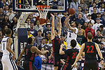 Nevada  guard Jalen Harris (2) shoots over San Diego State forward Yanni Wetzell  (5) during the first half of a basketball game against San Diego State at Lawlor Events Center in Reno, Nev., Saturday, Feb. 29, 2020. (AP Photo/Tom R. Smedes)