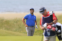 Jon Rahm (ESP) chips from a bunker at the 6th green and almost holes it during Thursday's Round 1 of the Dubai Duty Free Irish Open 2019, held at Lahinch Golf Club, Lahinch, Ireland. 4th July 2019.<br /> Picture: Eoin Clarke | Golffile<br /> <br /> <br /> All photos usage must carry mandatory copyright credit (© Golffile | Eoin Clarke)