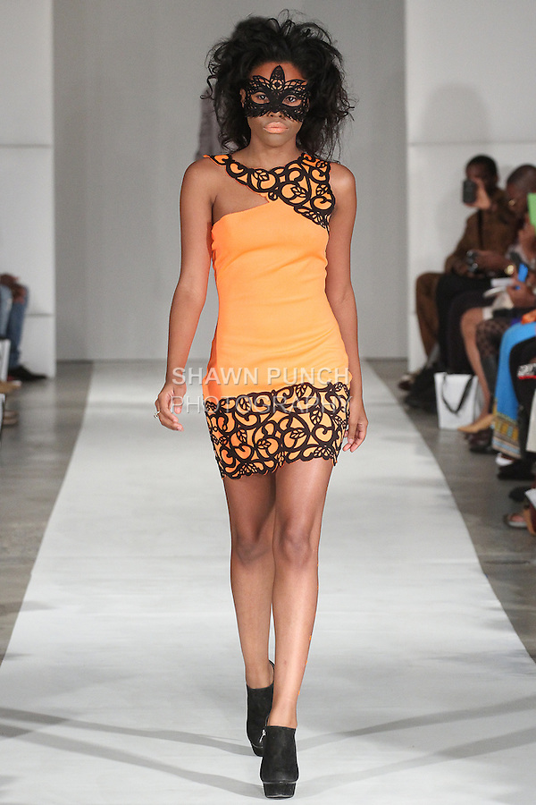 Model walks runway in an outfit from the John Guarnes Spring Summer 2015 collection, during Fashion Week Brooklyn Spring Summer 2015.