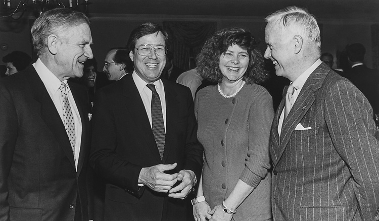 Rep. William E. Dannemeyer, R-Calif., Rep. Bill Thomas, R-Calif., wife Sharon Thomas and Rep. Amo Houghton, R-N.Y. at a party. (Photo by CQ Roll Call via Getty Images)