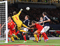 Martin Bogatinov punches clear under pressure from Jordan Rhodes in the Scotland v Macedonia FIFA World Cup Qualifying match at Hampden Park, Glasgow on 11.9.12.