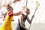 Los Angeles, CA 02/09/13 - Christy Turner  (Northwestern #24) and Paige Bonomi (USC #16) in action during the Northwestern vs USC NCAA Women Lacrosse game at the Los Angeles Colliseum.
