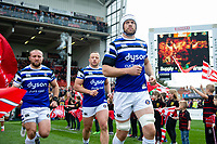 Dave Atwood and the rest of the Bath Rugby team run onto the field for the start of the match. Gallagher Premiership match, between Gloucester Rugby and Bath Rugby on April 13, 2019 at Kingsholm Stadium in Gloucester, England. Photo by: Patrick Khachfe / Onside Images