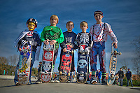 Five skateboarders pose for a photo at Halloween skateboarding event at Westerville Skate Park.