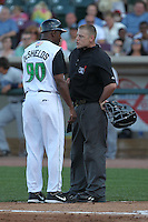 Dayton Dragons manager Delino DeShields #90 argues a call with home plate umpire Clay Park during a game against the Lake County Captains at Fifth Third Field on June 25, 2012 in Dayton, Ohio. Lake County defeated Dayton 8-3. (Brace Hemmelgarn/Four Seam Images)