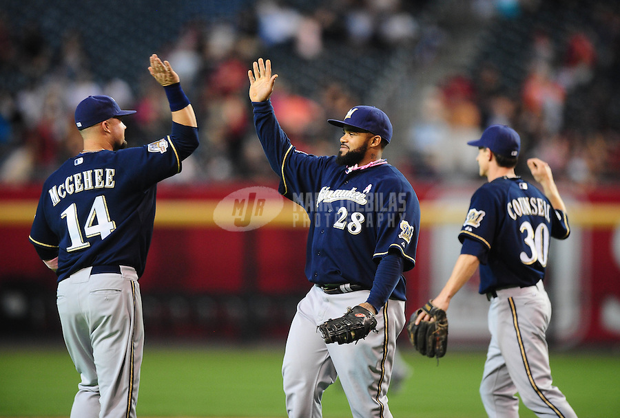 May 9, 2010; Phoenix, AZ, USA; Milwaukee Brewers third baseman (14) Casey McGehee , first baseman (29) Prince Fielder and shortstop (30) Craig Counsell celebrate following the game against the Arizona Diamondbacks at Chase Field. Players are wearing pink arm bands and using pink bats in honor of breast cancer awareness and Mothers Day. The Brewers defeated the Diamondbacks 6-1. Mandatory Credit: Mark J. Rebilas-