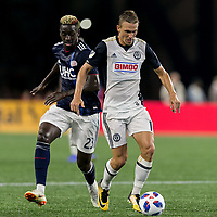 Foxborough, Massachusetts - August 11, 2018: First half action. In a Major League Soccer (MLS) match, New England Revolution (blue/white) vs Philadelphia Union (white), at Gillette Stadium.