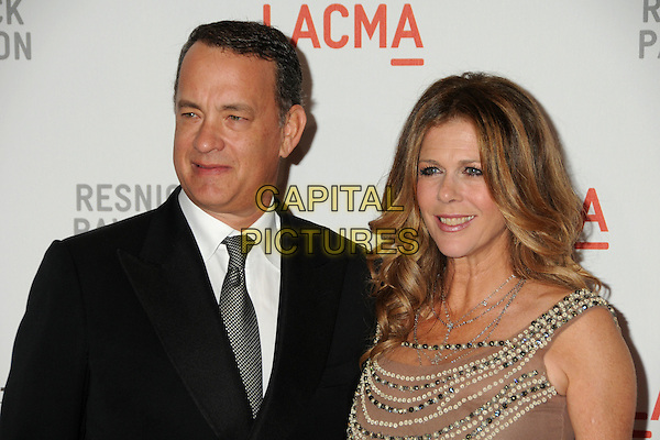 "TOM HANKS & RITA WILSON.LACMA's ""The Unmasking"" of the Lynda & Stewart Resnick Exhibition Pavilion Opening Gala held at the Los Angeles County Museum of Art, - Los Angeles, California, USA, 25th September 2010..portrait headshot black suit white shirt tie beige beaded embellished wife husband couple .CAP/ADM/BP.©Byron Purvis/AdMedia/Capital Pictures."