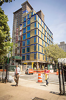 Construction on nARCHITECTS micro-unit modular apartments, branded Carmel Place, in the Kips Bay neighborhood of New York on Tuesday, June 30, 2015. The 65 prefabricated modules are designed for smaller households and will have affordable and market rate units. The units are between 260 and 360 square feet in size, and there will be communal spaces. (©Richard B. Levine)