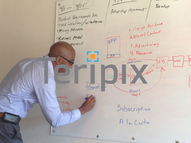 6/10/13 Lawrence Jenkins does a presentation on the white board during a meeting at the Eventrapix office in Dallas, TX.