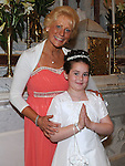 Lauren Drowney who received First Holy Communion in St. Cianan's church Duleek pictured with mam Breda. Photo: Colin Bell/pressphotos.ie
