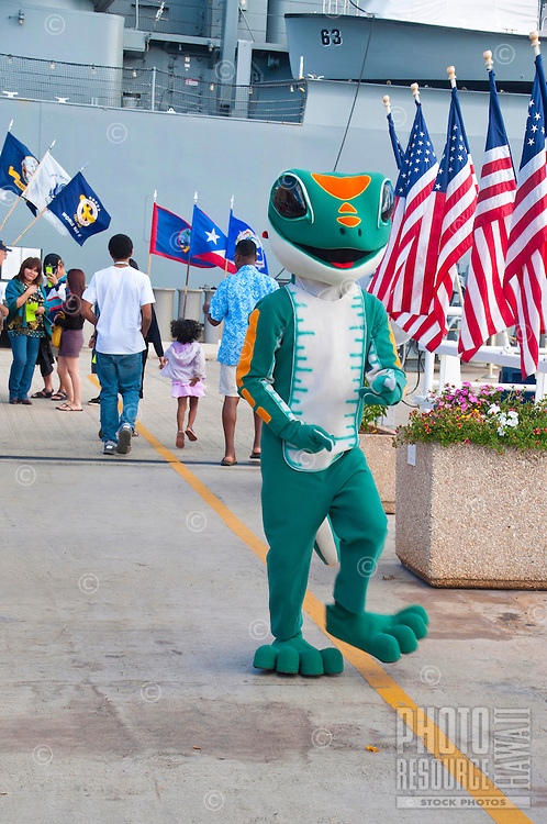 An interpreter is costumed as Hawai'i's beloved gecko at the battleship USS Missouri on Ford Island, Pearl Harbor, O'ahu.