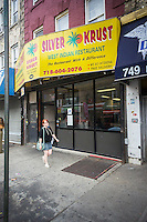 "A branch of the Silver Crust restaurant is seen in Crown Heights in Brooklyn in New York on Saturday, August 30, 2014. The Jamaican fast food eatery is being sued by its older rival, Golden Krust, for using their name, specifically, the misspelling of ""Krust"" which can cause confusion in consumers between the two chains. (© Richard B. Levine)"