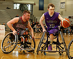 MARSHALL, MN - MARCH 17:  Dylan Fischbach #30 from the University Wisconsin Whitwater drives past Sean Burns #23 from Alabama during their championship game at the 2018 National Intercollegiate Wheelchair Basketball Tournament at Southwest Minnesota State University in Marshall, MN. (Photo by Dave Eggen/Inertia)