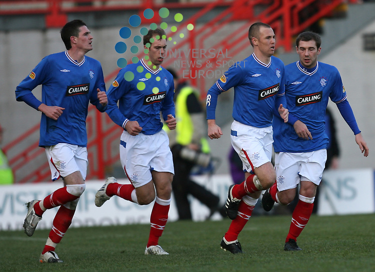 Kenny Miller scores from penalty to make it 3-3 congratulated by team mate Kyle Lafferty(left) Steven Whittaker(centre) and Kevin Thomson during the Active Nation Scottish Cup Fourth round match between Hamilton and Rangers at New Douglas Park 10/01/10. Picture By Ricky Rae/Universal News & Sport (Scotland).