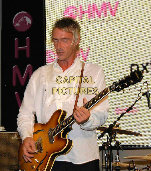 PAUL WELLER.AT HMV, London..October 10th, 2005.half length stage live gig performance music guitar.www.capitalpictures.com.sales@capitalpictures.com.©Capital Pictures