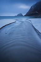 River flows through Haukland Beach, Vestvagoy, Lofoten Islands, Norway