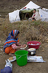 Following an October 8, 2005, earthquake, girls wash dishes outside their family tents in a camp outside Balakot sponsored by Church World Service/Action by Churches Together.