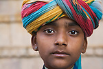 Rajasthani boy wearing colorful turban; Rajasthan, India --- Model Released