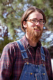 USA, Oregon, Ashland, Black Dog Farm farmer Tyler sells his produce at the Rogue Valley Growers and Crafters Market