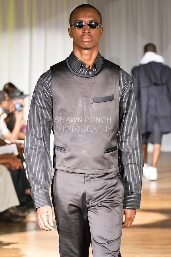 Model walks the runway in an Andrew Nowell outfit, during the Ray Vincente Menswear Showcase 2010 fashion show at Chacala Loft on June 18, 2010.