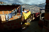 26 year old wrestler Yolanda La Amorosa (fighting name), Veraluz Cortez (real name) washes clothes on her rooftop. Veraluz is a Cholita, a wrestler of native Aymara descent. When Cholitas fight they wear traditional costume. Veraluz fights with the lucha libre (free wrestling) group Los Diosas del Ring. .