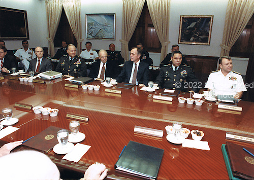 United States President George H.W. Bush meets with his military advisors in the Pentagon Gold Room at the Pentagon in Washington, D.C., the usual meeting place of the Joint Chiefs of Staff, on August 15, 1990 to discuss the U.S. military response to the Iraqi invasion of Kuwait. From left to right: White House Chief of Staff John Sununu; National Security Advisor Brent Scowcroft; General H. Norman Schwarzkopf, U.S. Army, Commander-in-Chief U.S. Central Command; U.S. Secretary of Defense Dick Cheney; President Bush; Chairman, Joint Chiefs of Staff Colin E. Powell; and Vice Chairman, Joint Chiefs of Staff, Admiral David E. Jeremiah, U.S. Navy.<br /> Mandatory Credit: Robert D. Ward / DoD via CNP
