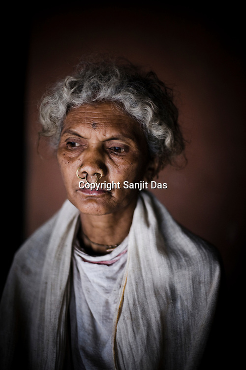Kochari Pusika poses for a portrait in Salpojola village in Niyamgiri hills. He is one of the many people who will get displaced if the aluminium company Vedanta carries on with its plans of mining of Bauxide in Niyamgiri hills in Rayagara district of Orissa in India.