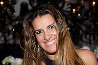 SAO PAULO, SP, 11 DE FEVEREIRO 2012. ANIVERSARIO HELINHO CALFAT. A empresaria Andrea Guimaraes, na festa de aniversario do promoter Helinho Calfat, realizada na casa da empresaria Cristiana Arcangeli, no Jardim Europa, regiao sul de SP, na noite deste sabado 11. (FOTO: MILENE CARDOSO - NEWS FREE)