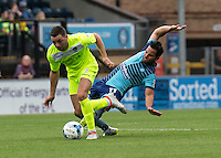 Sam Wood of Wycombe Wanderers tackles from behind on Drey Wright of Colchester United during the Sky Bet League 2 match between Wycombe Wanderers and Colchester United at Adams Park, High Wycombe, England on 27 August 2016. Photo by Liam McAvoy.