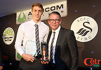 Pictured: Jay Fulton receives the Young Player of the Year award from Martin Morgan Wednesday 20 May 2015<br /> Re: Swansea City FC Awards Dinner at the Liberty Stadium, south Wales, UK