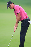 Wu Ashun (CHN) putts on the 9th green during Thursday's Round 1 of the 2014 BMW Masters held at Lake Malaren, Shanghai, China 30th October 2014.<br /> Picture: Eoin Clarke www.golffile.ie