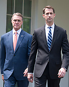 United States Senator David Perdue (Republican of Georgia), left, and US Senator Tom Cotton (Republican of Arkansas), right, walk to the microphones to speak to reporters outside the White House after meeting US President Donald J. Trump to discuss their proposed legislation to enact a skills-based immigration system called the Reforming American Immigration for a Strong Economy (RAISE) Act that they claim would also result in a lower level of immigration.<br /> Credit: Ron Sachs / CNP