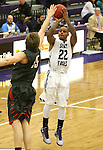 SIOUX FALLS, SD - JANUARY 16:  Charles Ward #22 from the University of Sioux Falls spots up for a jumper over Isaac Sevlie #55 from Minnesota Moorhead in the first half of their game Friday night at the Stewart Center.  (Photo by Dave Eggen/Inertia)