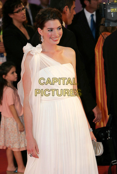 """ANNE HATHAWAY .The premiere of the film """"The Devil Wears Prada"""" during the ninth day of the 63rd Venice Film Festival in Venice, Italy. .September 7, 2006.Ref: CAT.half length white dress sheer hand on hip one shoulder .www.capitalpictures.com.sales@capitalpictures.com.©Cat/Capital Pictures."""