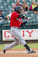 Oklahoma City RedHawks designated hitter Jonathan Villar (6) checks his swing during the Pacific Coast League baseball game against the Round Rock Express on August 1, 2014 at the Dell Diamond in Round Rock, Texas. The Express defeated the RedHawks 6-5. (Andrew Woolley/Four Seam Images)