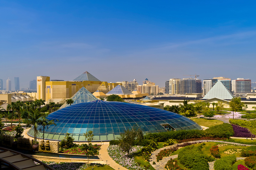 View from Raffles Dubai Hotel over Raffles Botanical Garden, with the Wafi City Mall (an Egyptian themed shopping mall) in background, Dubai, United Arab Emirates