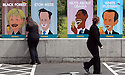 Shop staff fix their advert posters showing (L-R) German Chancellor Angela Merkel, British Prime Minister David Cameron, US President Barack Obama and Russian President Vladimir Putin, at a petrol station close to the G8 Summit in Lough Erne, Northern Ireland, Britain, 18 June 2013. Leaders from Canada, France, Germany, Italy, Japan, Russia, USA and UK are meeting at Lough Erne in Northern Ireland for the G8 Summit 17-18 June. The leaders were holding their second and final day of talks on 18 June, with the global economy and tax avoidance high on the agenda.  Photo/Paul McErlane