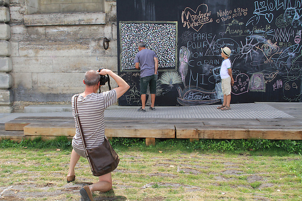 Visitors and artist along the Seine River, Paris, France, Europe. .  John offers private photo tours in Denver, Boulder and throughout Colorado, USA.  Year-round. .  John offers private photo tours in Denver, Boulder and throughout Colorado. Year-round.